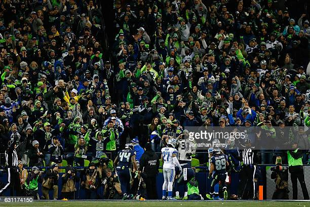Seattle Seahawks fans cheer after Paul Richardson of the Seattle Seahawks made a touchdown catch against Tavon Wilson of the Detroit Lions during the...