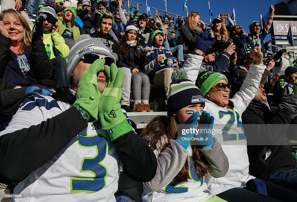 Seattle Seahawks fans cheer in a designated 'moment of noise' at ceremonies during the Super Bowl XLVIII Victory Parade at CenturyLink Field on February 5, 2014 in Seattle, Washington.