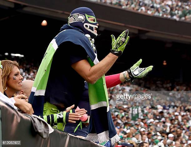 Seattle Seahawks fans cheer on their team in the fourth quarter against the New York Jets at MetLife Stadium on October 2 2016 in East Rutherford New...