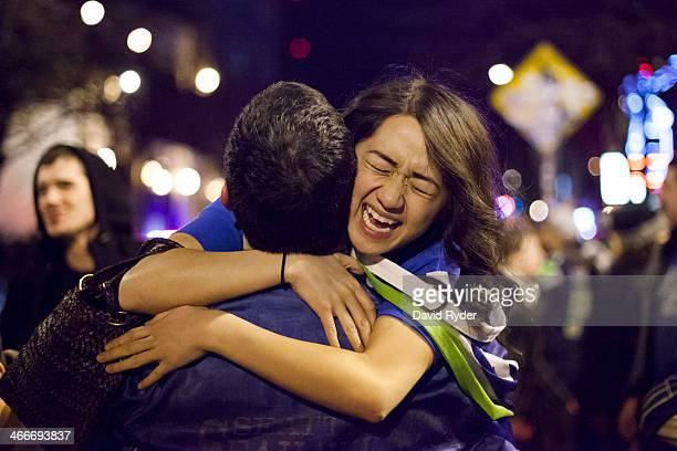 Seattle Seahawks fans embrace in the street after watching their team win the Super Bowl on February 2 2014 in Seattle Washington The Seahawks...