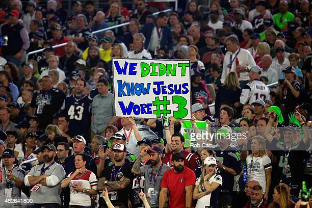 Seattle Seahawks fans hold a sign in the second half against the New England Patriots during Super Bowl XLIX at University of Phoenix Stadium on...