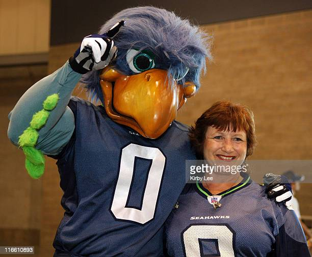 A Seattle Seahawks female fan poses wtih Seahawks mascot Blitz during tailgate festivities at Touchdown City in the Qwest Field Events Center in...