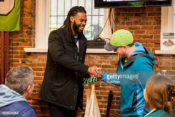 Seattle Seahawks football player Sidney Rice interacts with fans on December 12 2016 in Seattle Washington