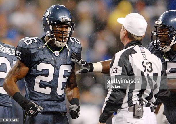 Seattle Seahawks free safety Ken Hamlin argues with referee Bill Carollo during the Monday night football game between the Seattle Seahawks and the...