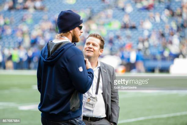 Seattle Seahawks General Manager John Schneider talks to USC snapper Jake Olson before a game between the Seattle Seahawks and the Indianapolis Colts...