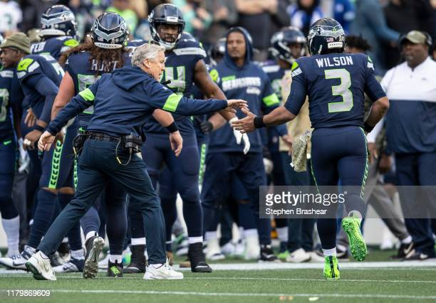 Seattle Seahawks head coach Pete Carroll congratulates quarterback Russell Wilson after a Seahawks touchdown during the second half of a game against...