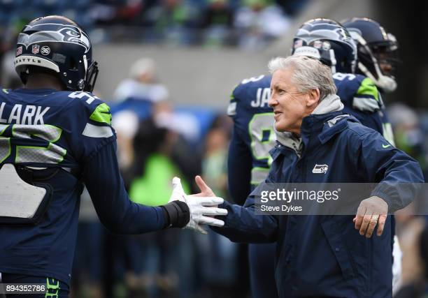 Seattle Seahawks head coach Pete Carroll greets Frank Clark on the field before the game against the Los Angeles Rams at CenturyLink Field on...