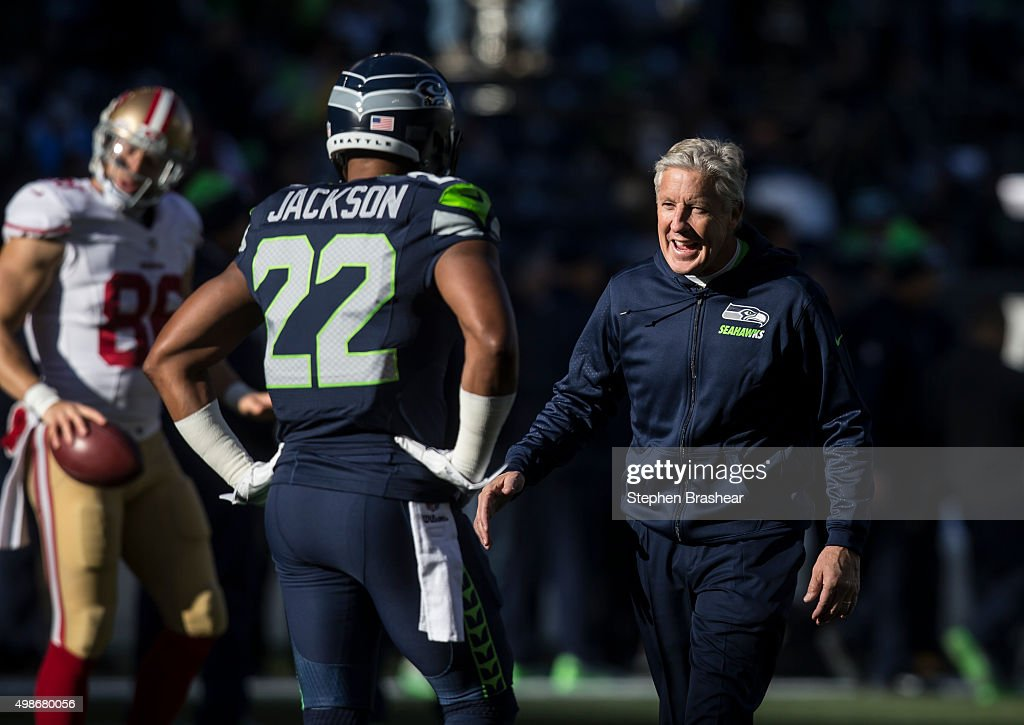 Seattle Seahawks head coach Pete Carroll greets running back Fred Jackson #22 of the Seattle Seahawks before the football game against the San Francisco 49ers at CenturyLink Field on November 22, 2015 in Seattle, Washington. The Seahawks won the game 29-13.