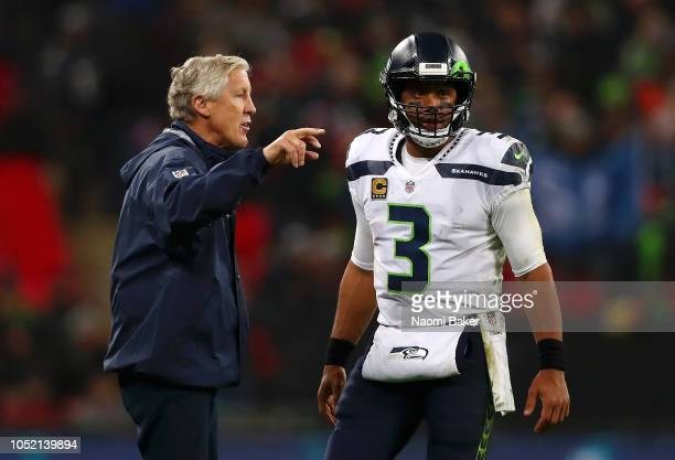 Seattle Seahawks Head Coach Pete Carroll speaks to Russell Wilson of Seattle Seahawks during the NFL International series match between Seattle...