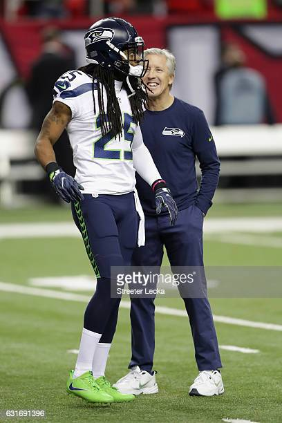 Seattle Seahawks head coach Pete Carroll stands with Richard Sherman of the Seattle Seahawks prior to the game against the Atlanta Falcons at the...