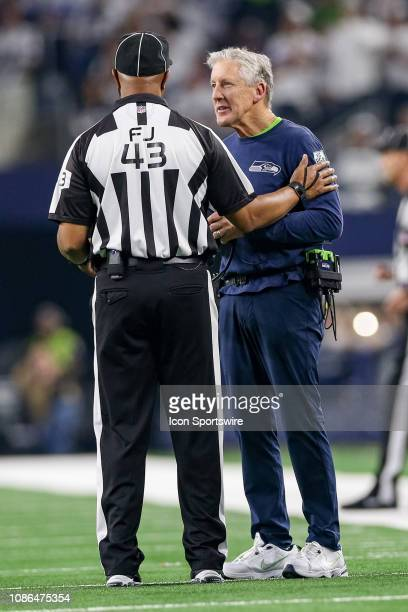 Seattle Seahawks head coach Pete Carroll talks with field judge Terry Brown during the NFC wildcard playoff game between the Seattle Seahawks and...