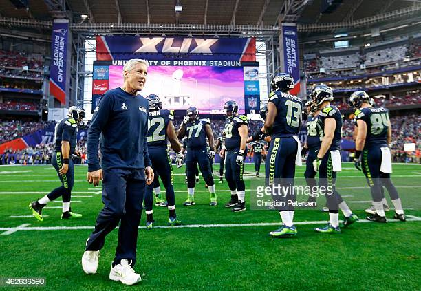 Seattle Seahawks head coach Pete Carroll walks on the field prior to Super Bowl XLIX at University of Phoenix Stadium on February 1 2015 in Glendale...