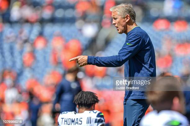 Seattle Seahawks head coach Pete Carroll walks the field before a game against the Denver Broncos at Broncos Stadium at Mile High on September 9 2018...