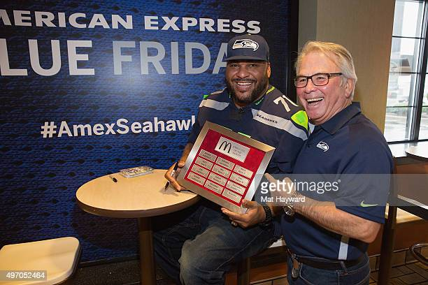 Seattle Seahawks legend Walter Jones receives 'employee of the month' status after he surpises fans in support of Blue Friday hosted by American...