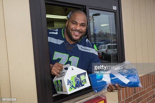 Seattle Seahawks legend Walter Jones surpises fans in support of Blue Friday hosted by American Express at McDonalds on November 13 2015 in Seattle...