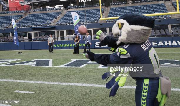 Seattle Seahawks mascot Blitz catches a football pass during American Express Dinner on the 50 at CenturyLink Field on August 29 2017 in Seattle...