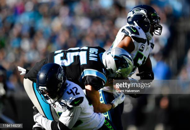 Seattle Seahawks middle linebacker Bobby Wagner intercepts a pass intended for Carolina Panthers wide receiver Chris Hogan in the game at Bank of...