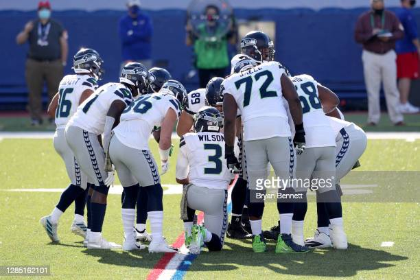 Seattle Seahawks offense huddles during the first quarter against the Buffalo Bills at Bills Stadium on November 08, 2020 in Orchard Park, New York.