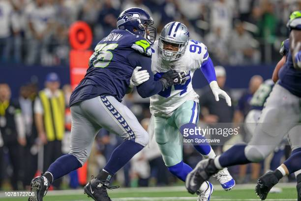 Seattle Seahawks offensive tackle Duane Brown blocks Dallas Cowboys defensive end Randy Gregory during the NFC wildcard playoff game between the...