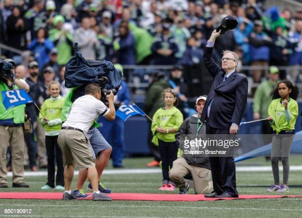 Seattle Seahawks owner Paul Allen acknowledges the crowd during a ceremony to celebrate the to 20th anniversary of his purchase of the team before a...