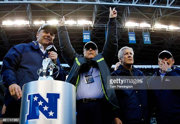 Seattle Seahawks owner Paul Allen and head coach Pete Carroll of the Seattle Seahawks celebrate after the Seahawks defeated the Green Bay Packers in...