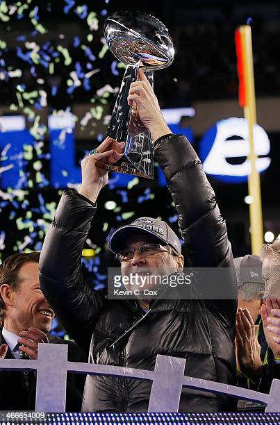 Seattle Seahawks Owner Paul Allen celebrates with the Vince Lombardi Trophy after their 438 victory over the Denver Broncos during Super Bowl XLVIII...