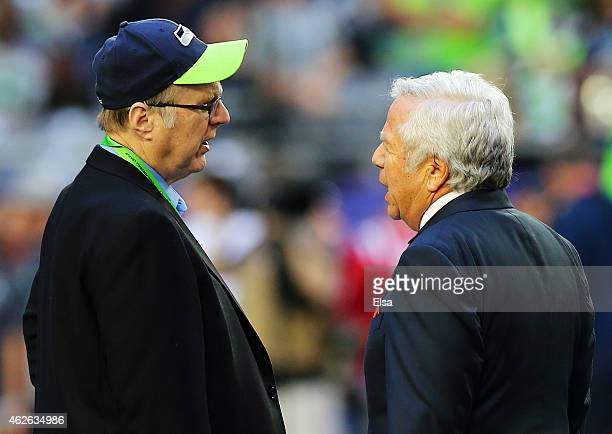 Seattle Seahawks owner Paul Allen talks with New England Patriots owner Robert Kraft on the field prior to Super Bowl XLIX at University of Phoenix...
