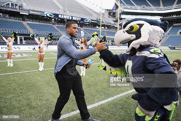 Seattle Seahawks player Bobby Wagner greets Blitz at American Express Dinner on the 50 at CenturyLink Field on August 27 2016 in Seattle Washington
