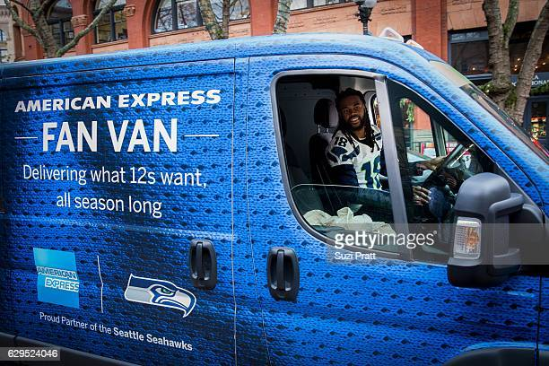Seattle Seahawks player Sidney Rice poses with the American Express Fan Van on December 12 2016 in Seattle Washington