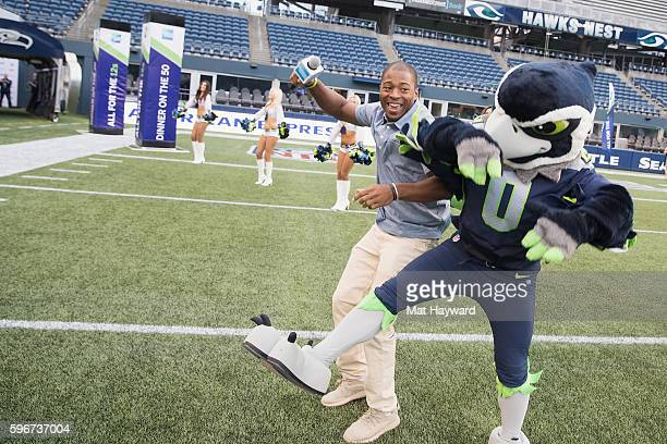 Seattle Seahawks player Tyler Lockett crashes into Blitz during American Express Dinner on the 50 at CenturyLink Field on August 27 2016 in Seattle...