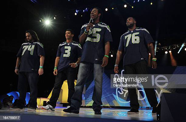 Seattle Seahawks players John Moffitt #3 QB Russell Wilson #25 Richard Sherman and Russell Okung show their support for youth activism in their...