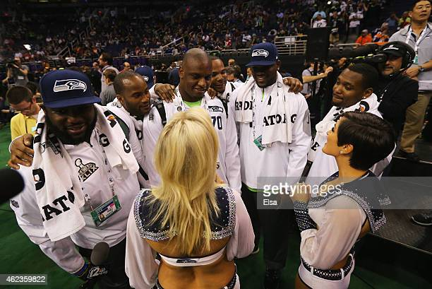 Seattle Seahawks players talk with cheerleaders at Super Bowl XLIX Media Day Fueled by Gatorade inside US Airways Center on January 27 2015 in...