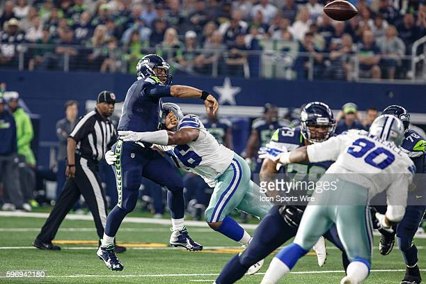 Seattle Seahawks Quarterback Russell Wilson [17722] is pressured by Dallas Cowboys Defensive End Greg Hardy [11364] during the NFL game between the...