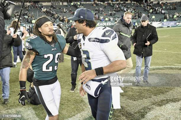 Seattle Seahawks quarterback Russell Wilson and Philadelphia Eagles cornerback Avonte Maddox shake hands during the Playoff game between the Seattle...