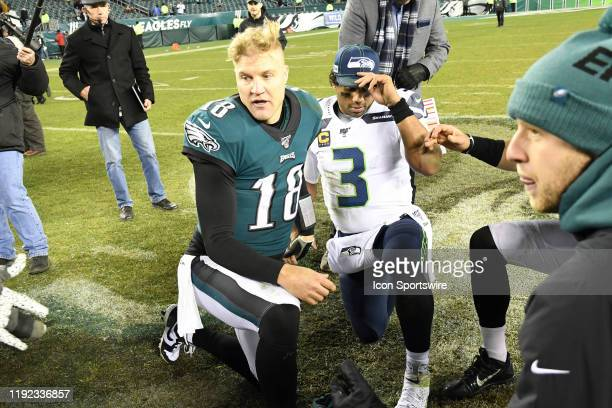 Seattle Seahawks quarterback Russell Wilson and Philadelphia Eagles quarterback Josh McCown take a knee during the Playoff game between the Seattle...