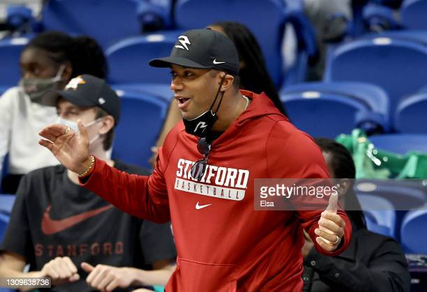 Seattle Seahawks quarterback Russell Wilson cheers on his sister Anna Wilson of the Stanford Cardinal in the first half against the Missouri State...