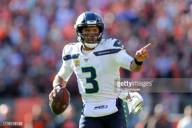 Seattle Seahawks quarterback Russell Wilson directs a receiver as he looks to throw during the fourth quarter of the National Football League game...