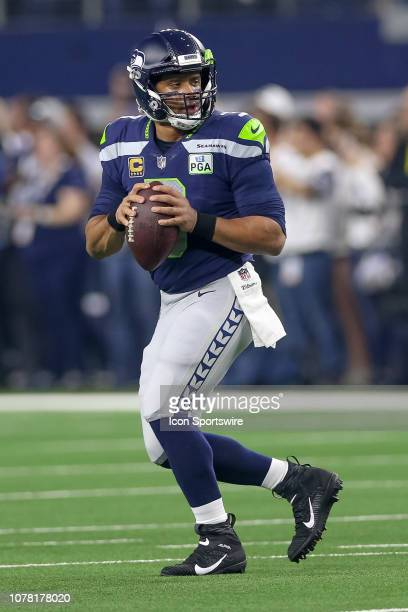 Seattle Seahawks quarterback Russell Wilson drops back to pass during the NFC wildcard playoff game between the Seattle Seahawks and Dallas Cowboys...