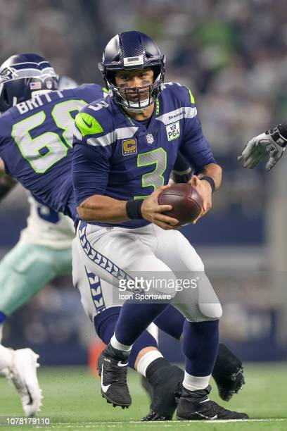 Seattle Seahawks quarterback Russell Wilson handles the ball during the NFC wildcard playoff game between the Seattle Seahawks and Dallas Cowboys on...