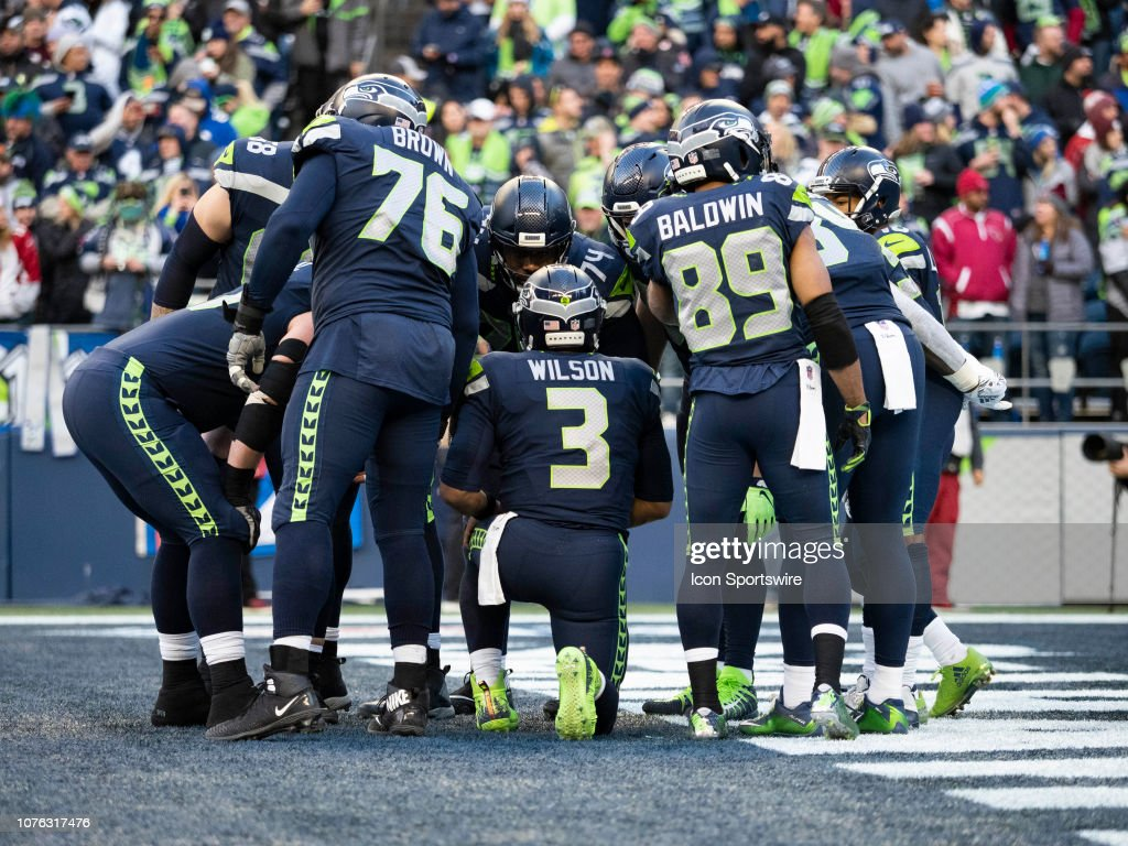 fffc17c3 Seattle Seahawks Quarterback Russell Wilson leads a huddle during ...