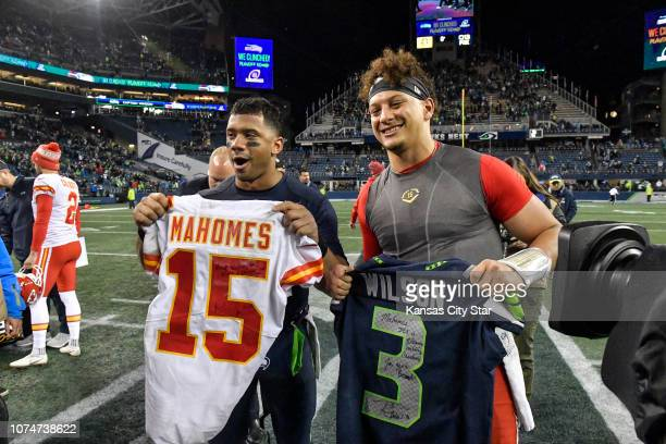 Seattle Seahawks quarterback Russell Wilson left and Kansas City Chiefs quarterback Patrick Mahomes exchange jerseys after Sunday's football game on...