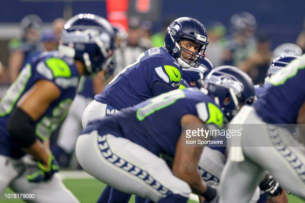 Seattle Seahawks quarterback Russell Wilson looks down the line during the NFC wildcard playoff game between the Seattle Seahawks and Dallas Cowboys...