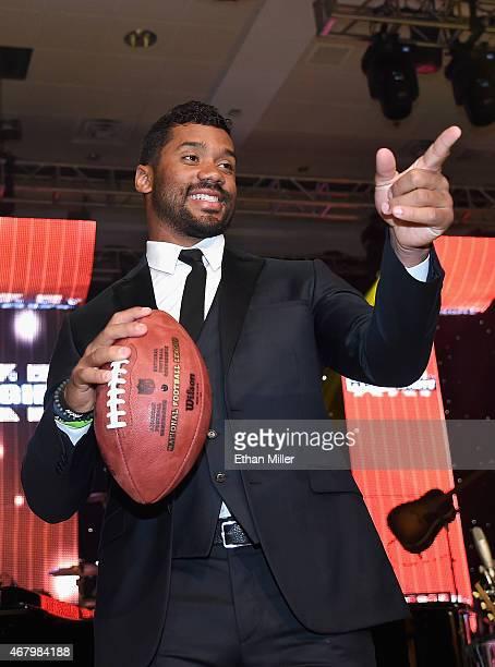 Seattle Seahawks quarterback Russell Wilson onstage during Muhammad Ali's Celebrity Fight Night XXI at the Jw Marriott Phoenix Desert Ridge Resort...