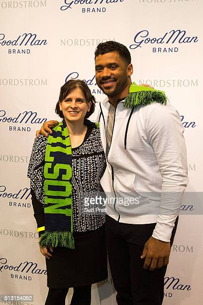 07febc87aac Seattle Seahawks quarterback Russell Wilson poses with a fan at Nordstrom  on February 29 2016 in