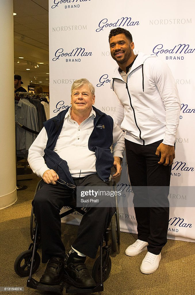 df3077c6540 Seattle Seahawks quarterback Russell Wilson poses with a fan at ...