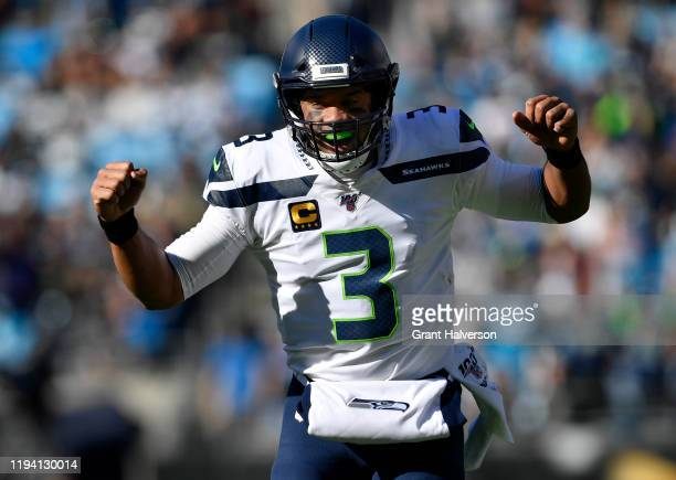 Seattle Seahawks quarterback Russell Wilson reacts to throwing a touchdown pass against Carolina Panthers in the first quarter at Bank of America...