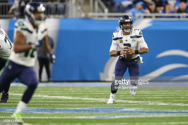 Seattle Seahawks quarterback Russell Wilson runs with the ball during a regular season game between the Seattle Seahawks and the Detroit Lions on...