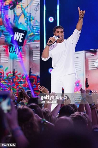 Seattle Seahawks Quarterback Russell Wilson speaks on stage during a surprise appearance at We Day at KeyArena on April 20 2016 in Seattle Washington