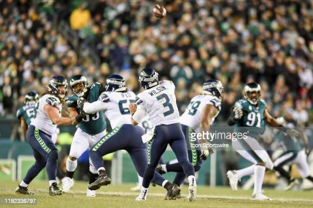 Seattle Seahawks quarterback Russell Wilson throws a touchdown pass during the Playoff game between the Seattle Seahawks and the Philadelphia Eagles...