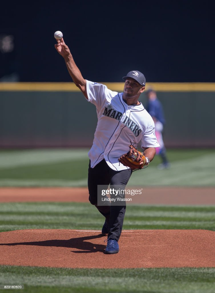 Seattle Seahawks quarterback Russell Wilson throws out the ceremonial first pitch before the game between the Seattle Mariners and Boston Red Sox at Safeco Field on July 26, 2017 in Seattle, Washington.